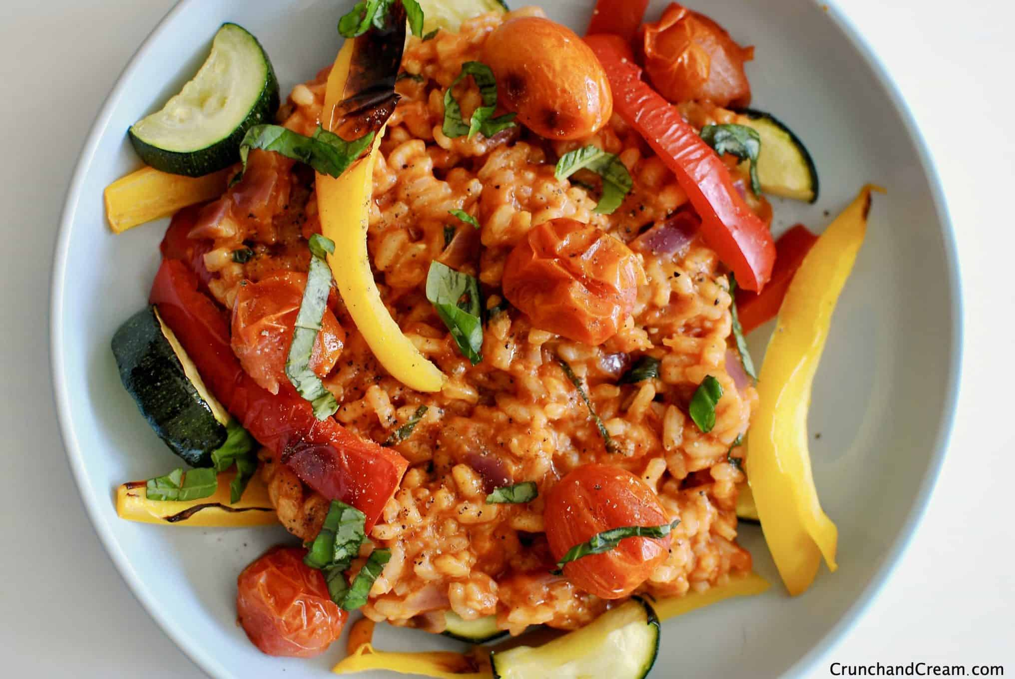 A rich and creamy risotto made with crushed tomatoes, served with chargrilled peppers, tomatoes and courgette to form a comforting and hearty vegetarian dinner.