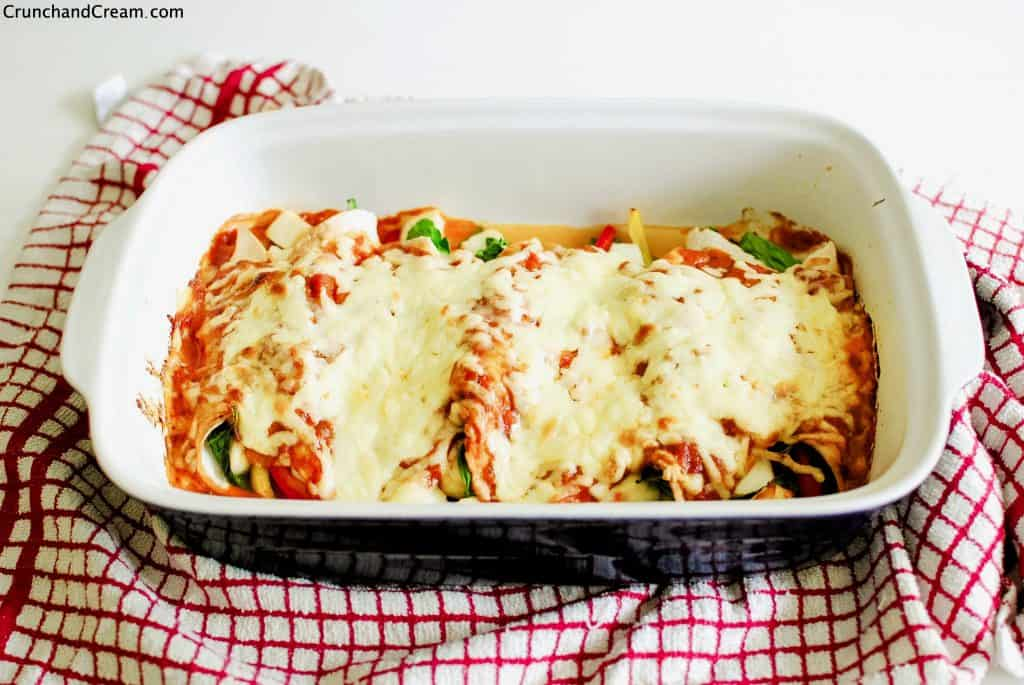 a dish of baked halloumi and spinach enchiladas