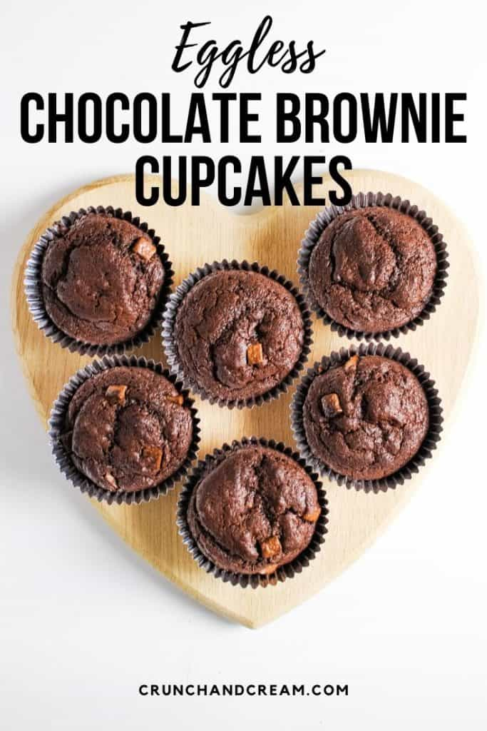 These simple eggless chocolate brownie cupcakes are moist and gooey thanks to plain yogurt and plenty of chocolate chips! #chocolatebrowniecupcakes #egglesscupcakes #chocolatecupcakes #yogurtcupcakes