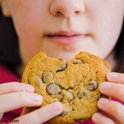 a child eating a chocolate chip cookie