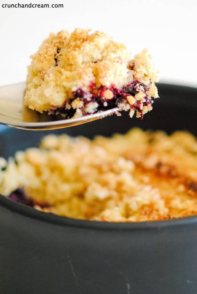 a spoonful of berry crumble over the dish of crumble