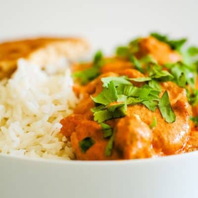bowl of rice and orange curry sauce